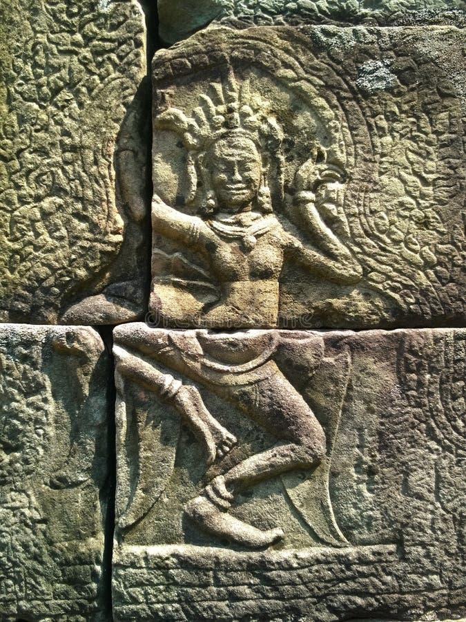 Den Apsara dansaren sned på väggen av den forntida templet för den Prasat Bayon en khmer Angkor Wat i Siem Reap, Cambodia royaltyfri bild
