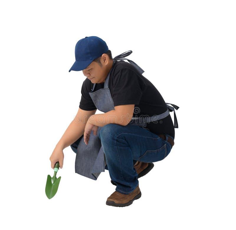Den arbetarmannen eller militären i svart skjorta och förkläde rymmer Sho fotografering för bildbyråer