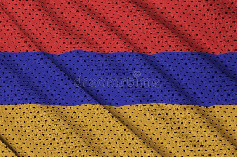 Den Armenien flaggan skrivev ut på ett tyg för ingrepp för polyesternylonsportswear arkivfoto