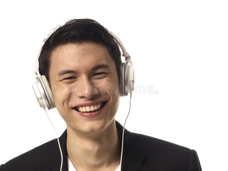 den asiatiska hörlurar man barn arkivfoto