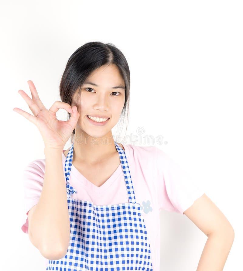 Den asiatiska hemmafrun är oken och ordnar till för arbete fotografering för bildbyråer