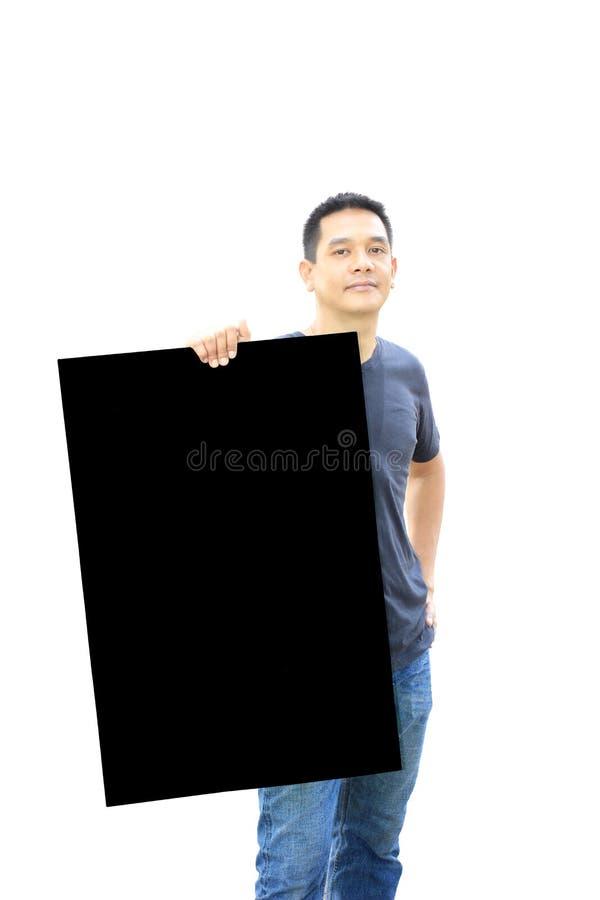 Den asiatiska mannen visar svart tavla på vit bakgrund royaltyfria bilder