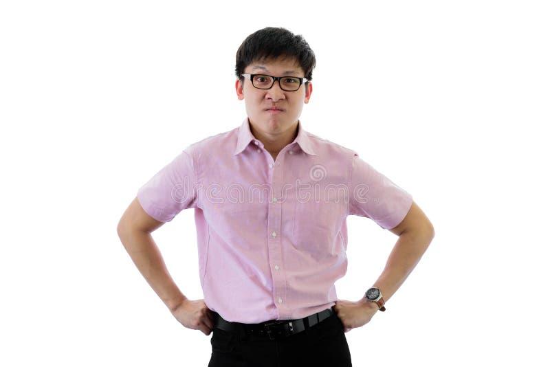 Den asiatiska unga aff?rsmannen har anseende med rubbning p? isolerat p? wihtebakgrund arkivbild