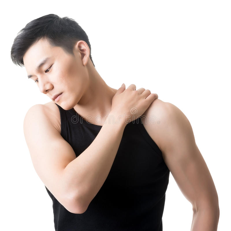Den asiatiska unga mannen som har skuldran, smärtar arkivfoto