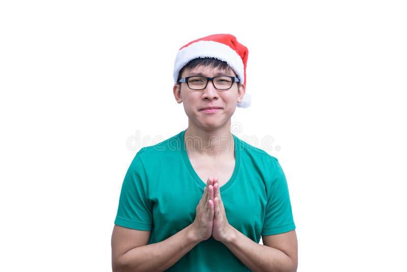 Den asiatSanta Claus mannen med glasögon och den gröna skjortan har att plädera royaltyfria bilder