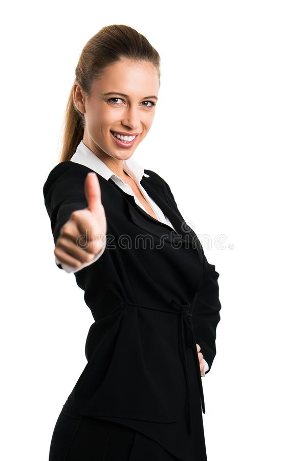 Den attraktiva affärskvinnan med tummen gör en gest upp arkivfoto