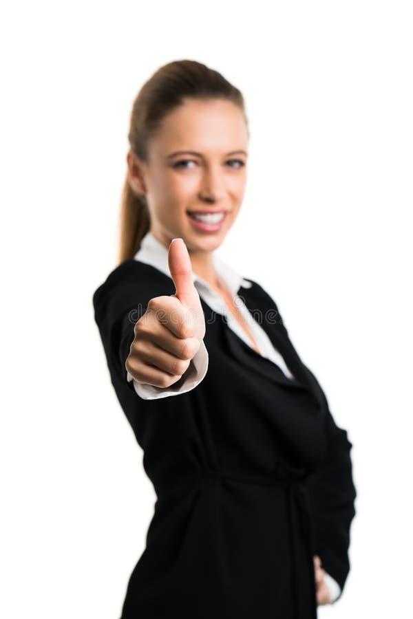 Den attraktiva affärskvinnan med tummen gör en gest upp arkivfoton