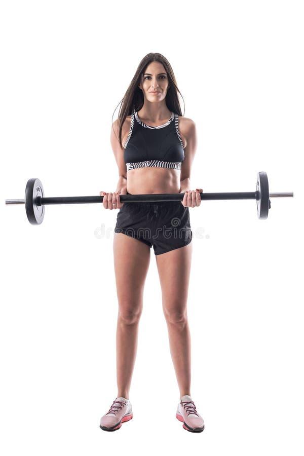 Den attraktiva frihetskvinnan som håller barklocka på att träna biceps royaltyfria bilder