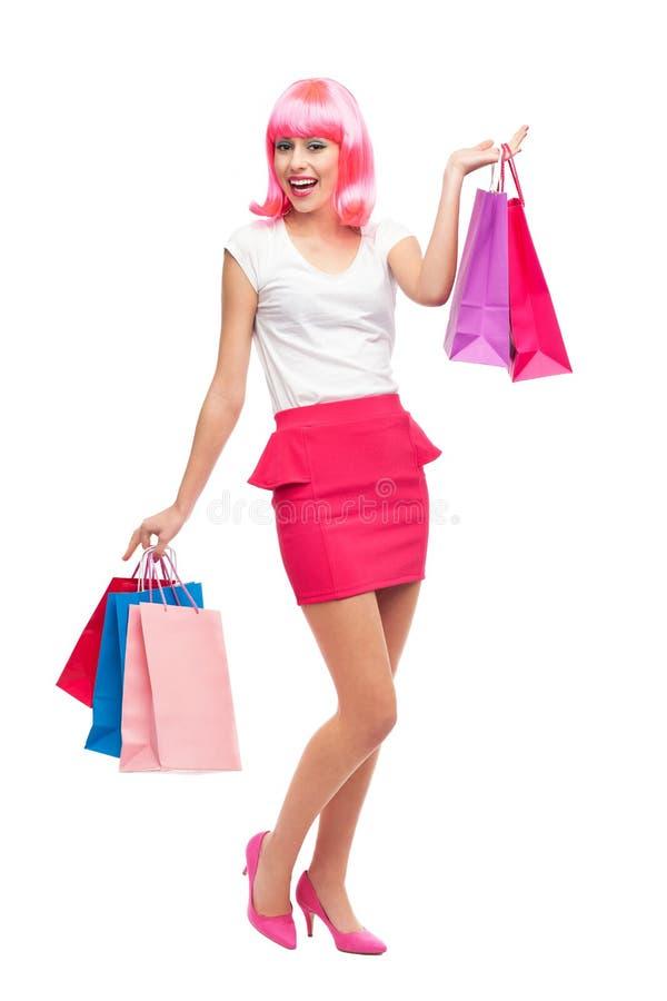 Den Attraktiva Kvinnan Med Shopping Hänger Lös Arkivbild