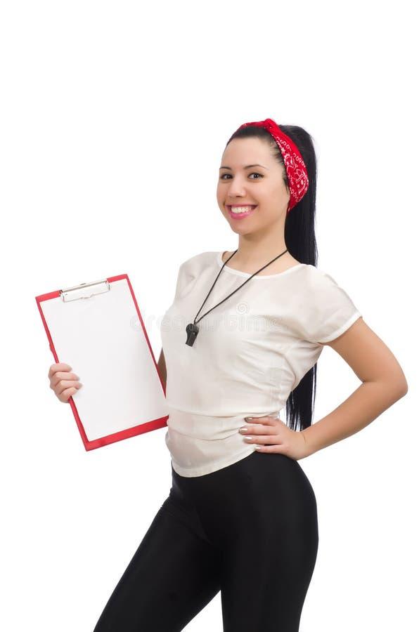Den attraktiva kvinnliga konditioninstrukt?ren som isoleras p? vit fotografering för bildbyråer