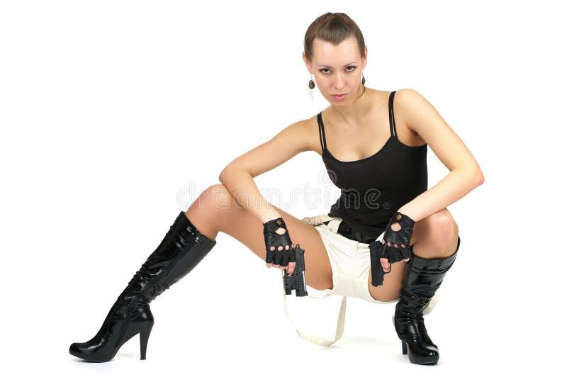 den attraktiva kvinnlign guns två arkivfoto