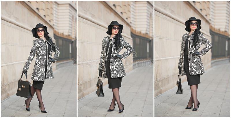 Den attraktiva unga kvinnan i en vinter danar skjutit Härlig trendig ung flicka i svart som poserar på aveny Elegant brunett royaltyfri foto