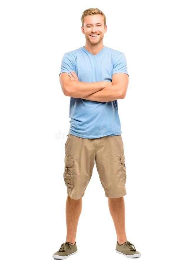 Den attraktiva unga mannen med armar vek på vit bakgrund arkivfoto