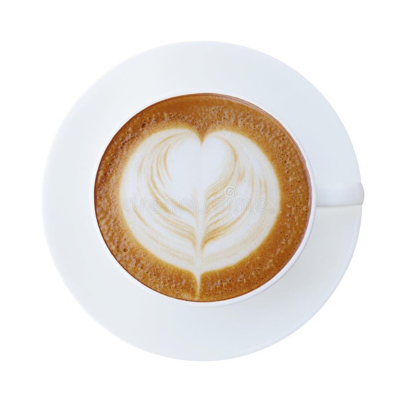 Den bästa sikten av den varma koppen för kaffelattecappucinoen med hjärta formade foa arkivbild