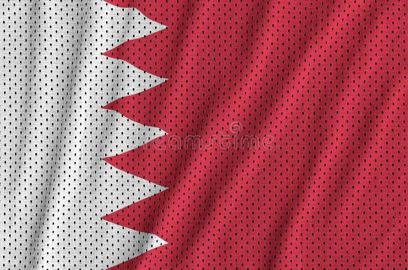 Den Bahrain flaggan skrivev ut på ett tyg för ingrepp för polyesternylonsportswear fotografering för bildbyråer