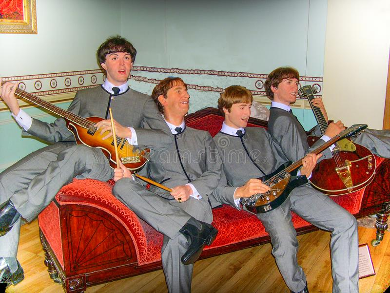 Den Beatles musikmusikbandet, vaxmuseum för madam Tussauds, London, England arkivbilder