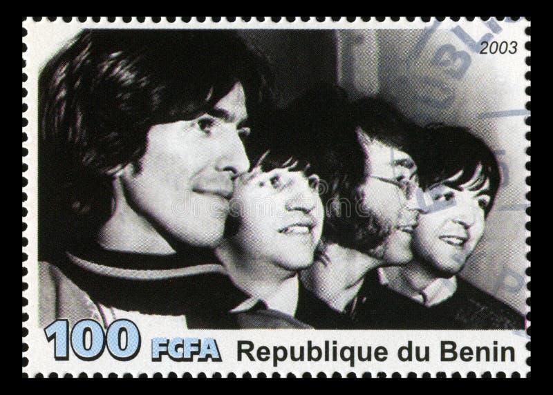 Den Beatles portostämpeln från Benin arkivbild