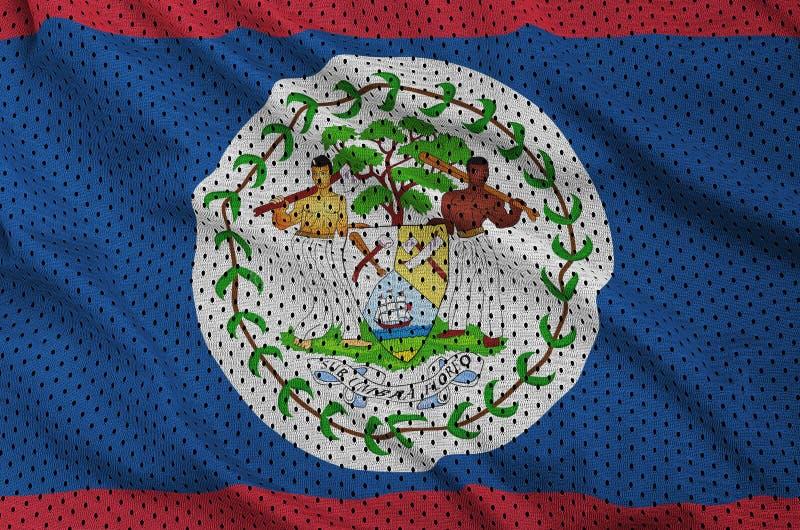 Den Belize flaggan skrivev ut på ett tyg för ingrepp för polyesternylonsportswear arkivfoton