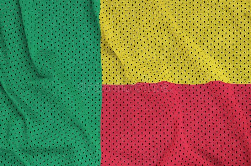 Den Benin flaggan skrivev ut på ett tyg för ingrepp för polyesternylonsportswear w royaltyfri foto