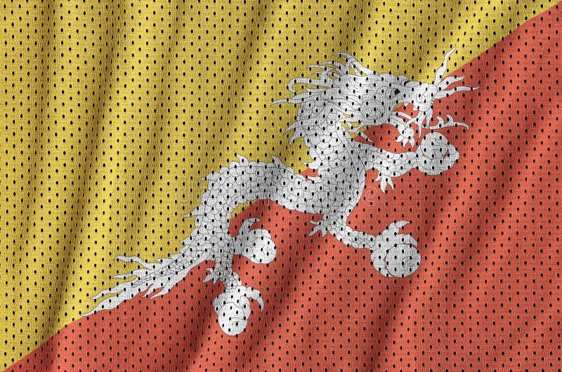 Den Bhutan flaggan skrivev ut på ett tyg för ingrepp för polyesternylonsportswear royaltyfria foton