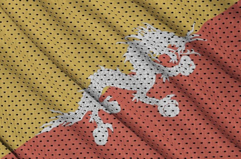 Den Bhutan flaggan skrivev ut på ett tyg för ingrepp för polyesternylonsportswear arkivbilder