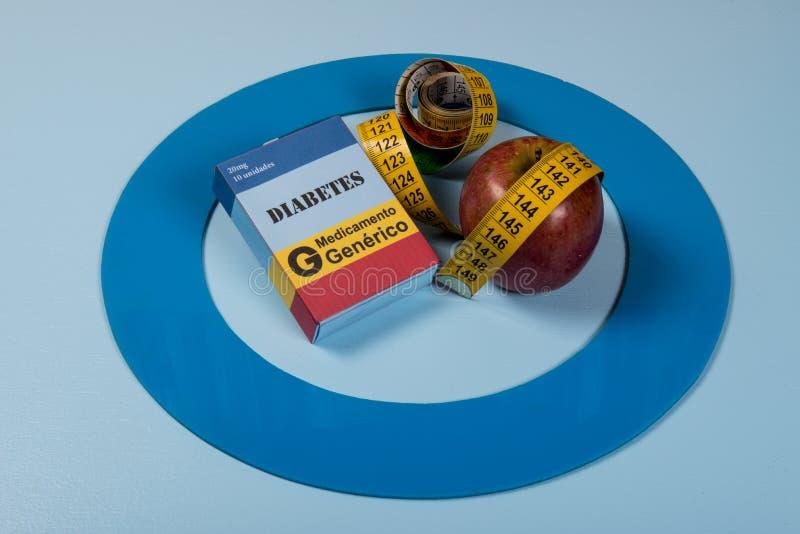 Den blåa cirkeln med någon sockersjukautrustning gör behandling sjukdomen arkivbilder