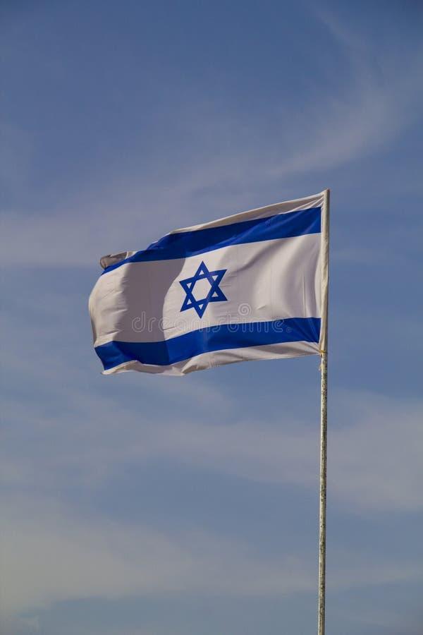 Den blåa och vita nationsflaggan av Israel royaltyfria bilder