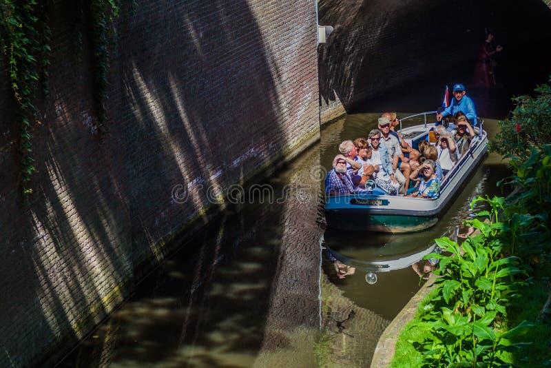 DEN BOSCH, NETHERLANDS - AUGUST 30, 2016: Tourist boat on a canal in Den Bosch, Netherlan. Ds stock photo