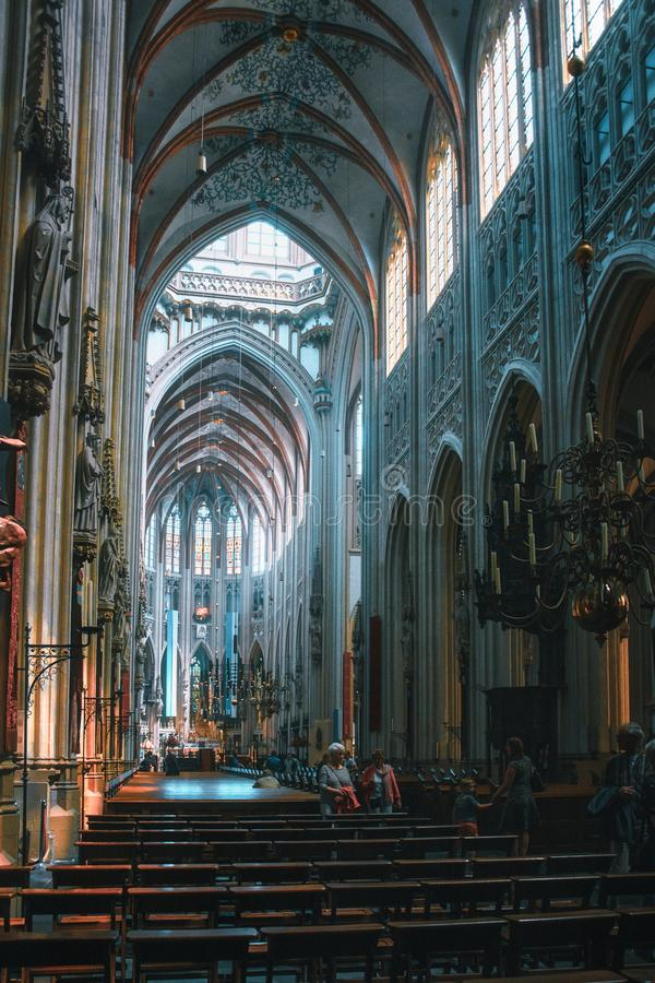 The interior of the famous Sintjans Cathedral of Den Bosch in the Netherlands. Den Bosch, Netherlands, May 24, 2015: The interior of the famous Sintjans stock images