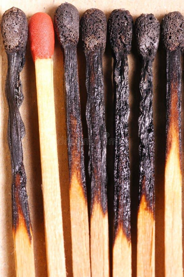 den brända matchen passar till red arkivbild