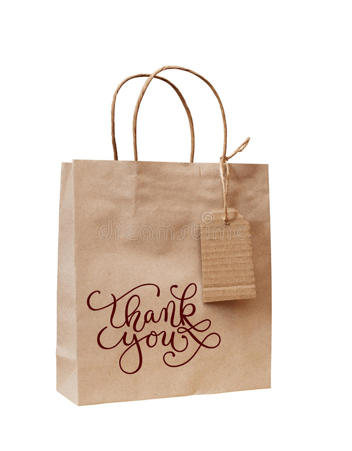 Den bruna kraft pappers- påsen för gåva med ord tackar dig royaltyfria bilder