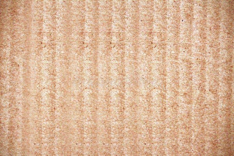 Den bruna pappers- asken, abstrakt pappbakgrund arkivbild
