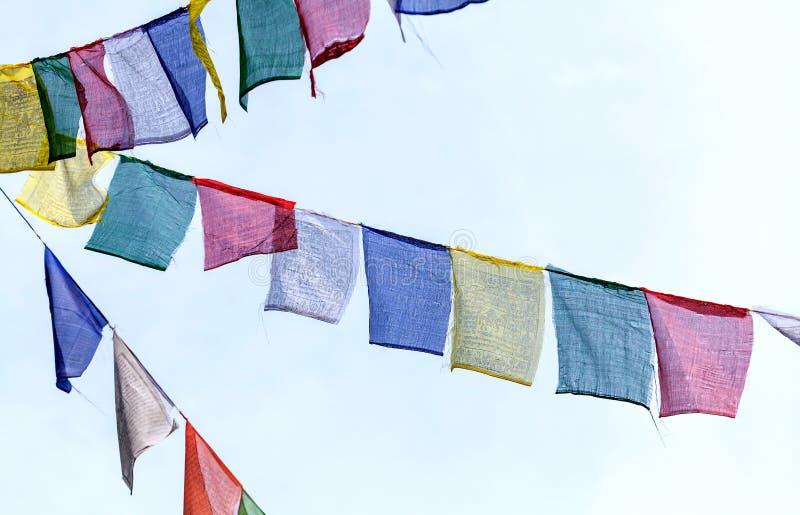 Den buddistiska bönen sjunker t royaltyfri foto