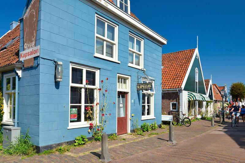 Hairdresser and barber shop in beautiful traditional Dutch blue building in side street of city Den Burg on island Texel royalty free stock photos