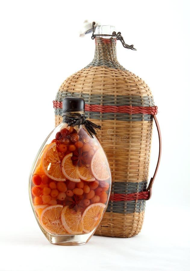 den buteljerade flaskan bär fruktt wine arkivfoton