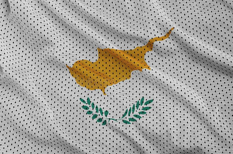 Den Cypern flaggan skrivev ut på ett tyg för ingrepp för polyesternylonsportswear royaltyfria bilder