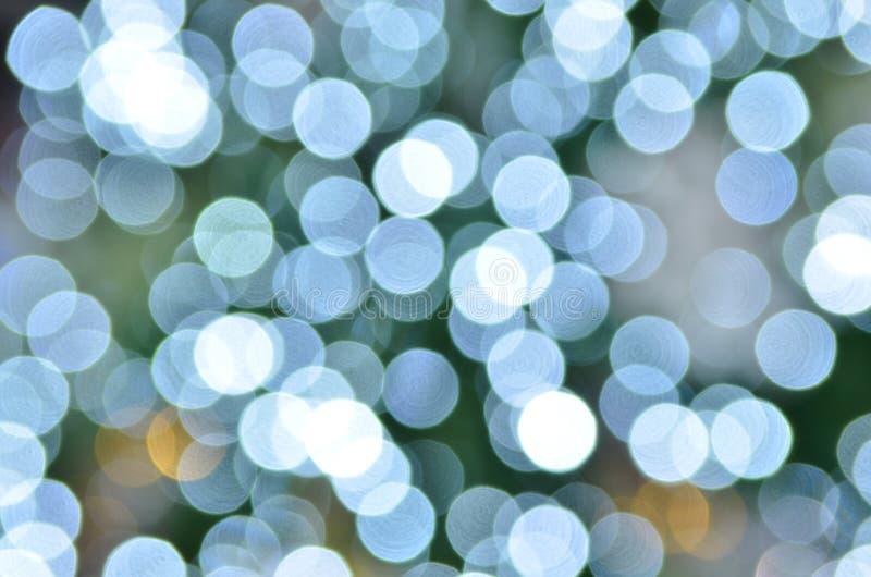 Den Defocused abstrakt blåttjulen tänder arkivfoton