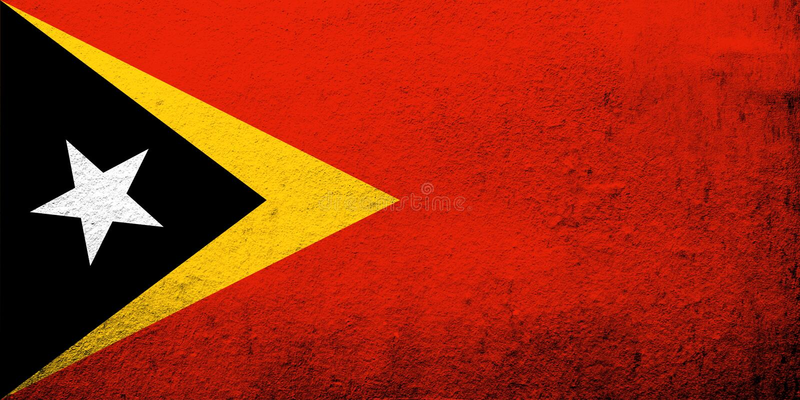 Den demokratiska republiken av den Timor-Leste Östtimor nationsflaggan Kan användas som en vykort arkivfoto
