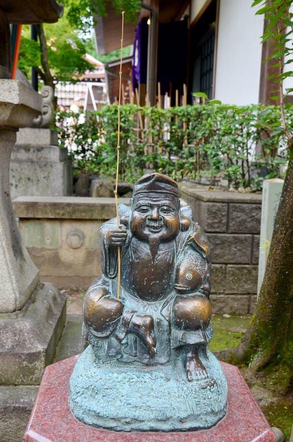 Den Ebisu statyguden av fishers eller köpmän är de sju gudarna av Fo arkivfoto