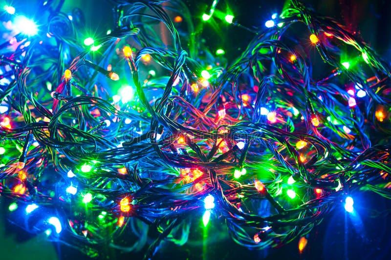 Den elektriska girlanden, jul gör sammandrag bakgrund royaltyfri bild