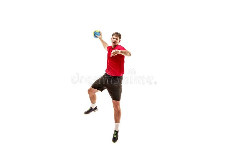 Den en caucasian unga mannen som handbollspelaren på studion på vit bakgrund arkivbilder
