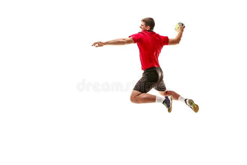 Den en caucasian unga mannen som handbollspelaren på studion på vit bakgrund arkivfoton