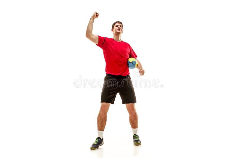 Den en caucasian unga mannen som handbollspelaren på studion på vit bakgrund arkivfoto