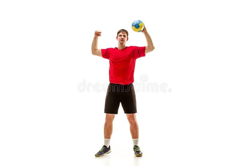 Den en caucasian unga mannen som handbollspelaren på studion på vit bakgrund royaltyfri bild
