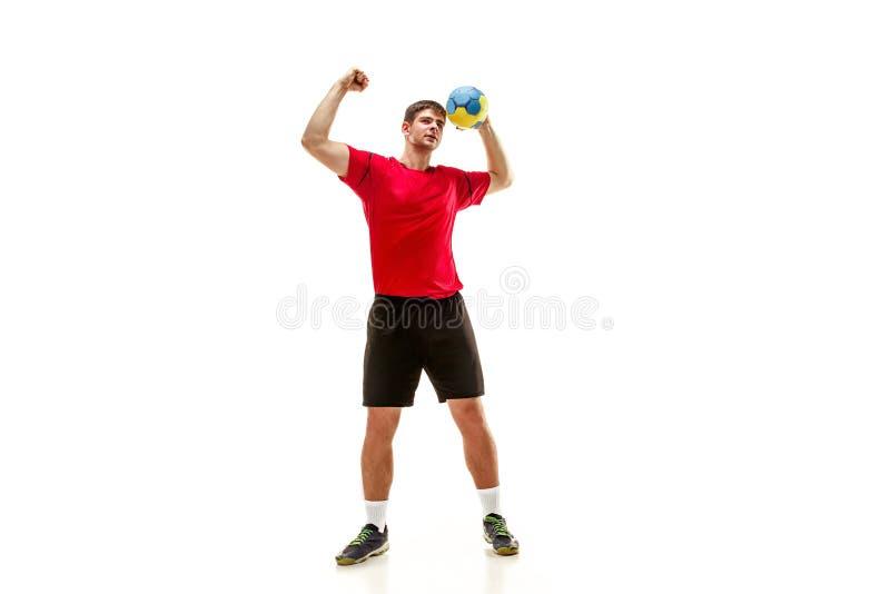 Den en caucasian unga mannen som handbollspelaren på studion på vit bakgrund royaltyfria foton