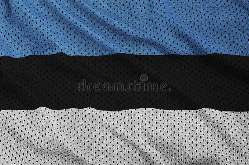 Den Estland flaggan skrivev ut på ett tyg för ingrepp för polyesternylonsportswear royaltyfri foto