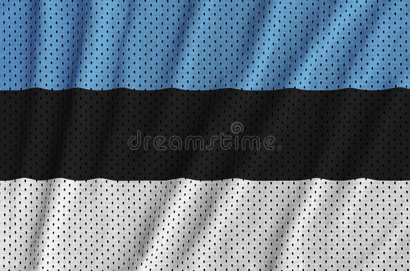 Den Estland flaggan skrivev ut på ett tyg för ingrepp för polyesternylonsportswear arkivbilder