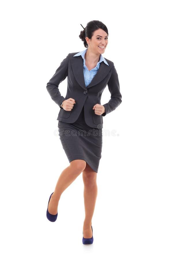 Den extatiska affärskvinnan passar in dans royaltyfria bilder