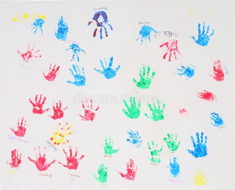 den färgrika handen skrivar ut white arkivfoton