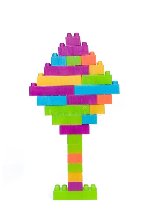 Den färgrika legoen blockerar treen arkivfoton